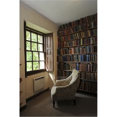 books, a chair, and a window