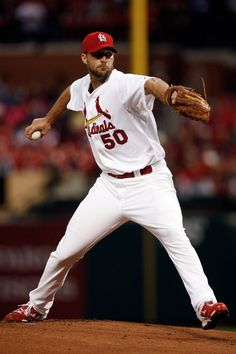 starting pitcher Adam Wainwright throws during the first inning of a baseball game against the Chicago Cubs. Cards won 4-3 in the 12th inning. 5-12-14
