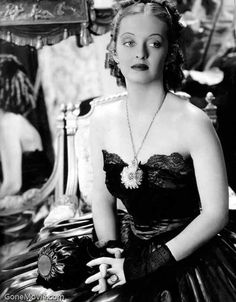 """Julie Marsden (Bette Davis): """"This is 1852, dumplin'. 1852, not the Dark Ages. Girls don't have to simper around in white just because they're not married."""" -- from Jezebel (1938) directed by William Wyler"""