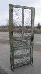 old dilapidated door  barbed wire spirals