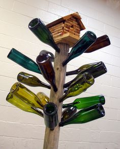 What's not to love about a bottle tree topped off his a birdhouse made from corks?