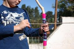 How to make a bow and arrow out of twigs, yarn, and fishing wire