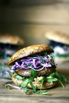 portabello burger with red coleslaw, avocado salsa and china rose sprouts.