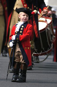 John Fox, 4, of Wolcott, Conn. leads the Mattatuck Fife and Drum Corp. as Junior Major in the annual Derby-Shelton Memorial Day Parade. In his first year as Junior Major, John leads the oldest active fife and drum corp in the nation, established in 1767, through the downtown streets.
