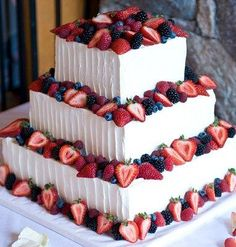 Layered lemon cake/blueberry filling and white cake/strawberry filling.  Perfect for a summer wedding!