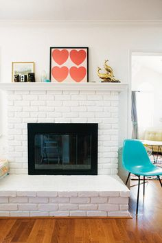 white brick fireplace and pop of turquoise