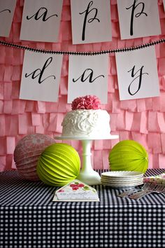 cute idea of cutting tissue (or crepe) paper into fringe for a party backdrop