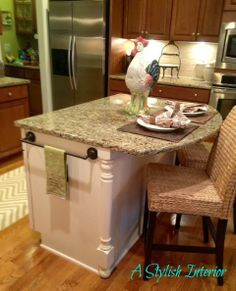 Kitchen island idea but in a different cabinet color than white to match the dark cabinets.