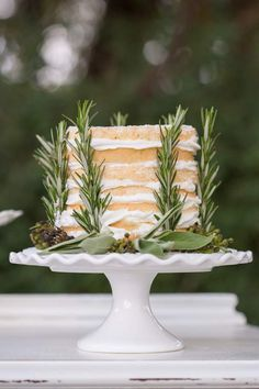 Naked cake with rosemary | Designs by Hemingway and Jeannemarie Photography | see more on: http://burnettsboards.com/2014/07/vintage-bohemian-polo-inspired-wedding-hawaii/