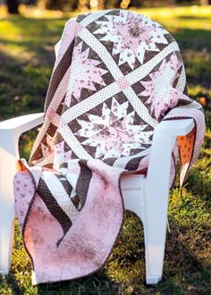 Enchanted by the sweet pink, antique cream, and chocolate brown quilt fabrics, designer Kimberly Jolly decided to showcase them in her quilt, Strawberry Skies.
