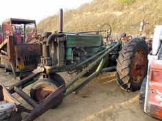 Antique John Deere 60 tractor salvaged for used parts. Call 877-530-4430 for the best selection of used ag parts. http://www.TractorPartsASAP.com