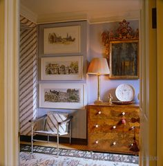 John Stefanidis ~ A collection of watercolours of Indian landscapes by Teddy Millington Drake in the bedroom which is decorated with antique Indonesian batiks