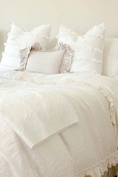 white ruffled bedding