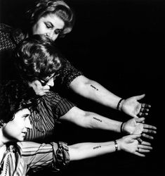 New York, United States, Three women display their camp numbers tattooed on their arms, Postwar.