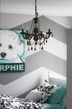 chevron walls + chandelier.