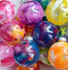 Weekend project: transform plain glass ornaments with melted crayons and a hair dryer using this ingenious tutorial.