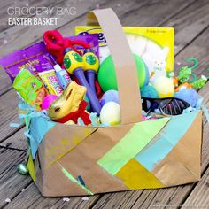 Grocery Bag Easter Basket for Boys! Learn how to braid strips of brown paper bags to create an Easter basket. This boy's Easter basket has lots of non-sugary toys and treats to play with. Plus, a bit a chocolate! Sponsored by Kroger.