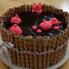 Redneck Piggy Pool Cake  - I used Wilton fondant mix for the pigs and too much pink dye. Pirouline cookies from Dollar General for the barrel - this was a nice thick 2 tier cake and kit kat's were too short. For the mud I just melted store bought frosting in the microwave and poured it in. pig cake with kit kats, piggi pool, pool cake