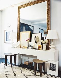 Love the layered art, huge mirror, sculptural lamps, Beni Ourain rug #styling #vignette #decor #decorating