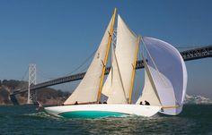 Sailing near a bridge.
