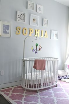 Love the sweet simplicity of this gallery wall with baby's name over crib! #gallerywall #nursery