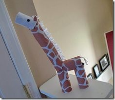 Very clever...a giraffe with toilet paper rolls.