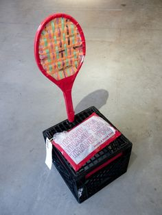 "THE CHAIR PEOPLE COLLECTIVE  ""12 Break Point Chair""  Milk Crate, Salvaged Aluminium Tennis Racquet, Woven Plastic Bags, Tape, Plastic Bag Cushion, Duct Tape (2011)  1% - $112,000  99% - $99"