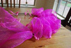 How to make a deco mesh wreath tutorial.  Great pictures, looks super easy!