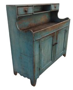 Z431 Beautiful  mid 19th century Lehigh Valley Pennsylvania High Back Drysink, with outstanding robin egg blue paint, this Drysink has scalloped sides , nice high back with two dovetailed drawers with an opening in the center  for soap. ,scalloped cute out foot .  Two paneled doors , unpainted clean interior, circa 1840 all original.