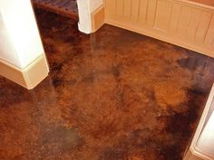 Stained concrete floors are a beautiful and easy to clean alternative to tile.  As a bonus they help to keep your house cooler!  We are having these put in our new house.