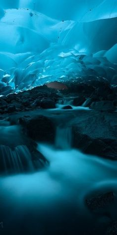 Underwater ice cave I couldn't imagine seeing this in person, I would probably start crying while having spasms on the ground. -.-