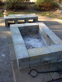 $ 75 DIY Fire Pit and loving the concrete benches in the back. 6 pavers 30 something concrete blocks.