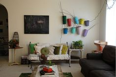 Love a cozy, lived in space. LOVE the colorful planters and chalkboard
