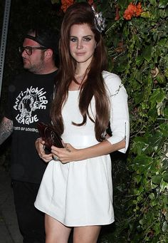 Lana Del Rey's hair has grown even bigger. The Video Games star has been spotted sporting a massive 60's-style bouffant. Are you going to see Lana Del Rey at one of her forthcoming UK festival appearances at the Latitude and Isle of Wight festivals?