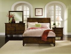 red, green, tan & white bedroom with dark wood furniture - like