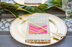 outdoor bridal shower brunch (with gold fringe, magnolia garlands, gold chargers, pink and orange coasters, gilded arrows) / reality and retrospect