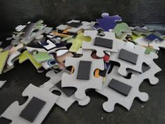 Put magnets on the backs of puzzle pieces.  Do puzzles on metal cookie sheets in the car!