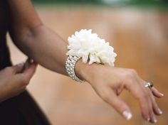 Mom and grandma corsage: modern corsage: pearl bracelet with one big bloom. Cute idea