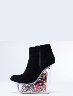 "6. Jeffrey Campbell It's a party on heels! The ""Icy"" shoe by Jeffrey Campbell is filled with loose confetti and retails for $255. Props for creativity. Negative props for setting people up to topple to their plastic doom. Source: solestruck.com  #flipflop #heel #freeyourtoes"