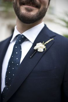 Crisp Navy Grooms Suit with a Polka Dot Tie   BRC Photography   See More! http://heyweddinglady.com/impossibly-chic-modern-art-inspired-wedding/