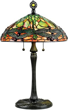 Quoizel European Style Table Lamp $230 This lamp is a twist on one of Tiffany Studio's most popular designs. The Dragonfly design is most often attributed to Clara Driscoll, one of the first female artisans employed by Tiffany. It was first introduced in 1899, then used in several variations through 1913. The timeless beauty of the natural world is captured in bright greens and oranges, with lacy, filigree-winged dragonflies as the imagery focus. It is a fine example of true Art Nouveau style.