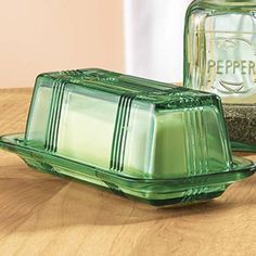 Green Depression Glass Butter Dish. This sat on the table at my Mother-In-Law's house the whole time I knew my wife's family. Wonder whatever happened to this and the other green glass pieces like it.