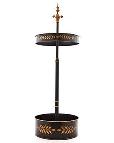 Umbrella stand from William Wayne & Co.; william-wayne.com.