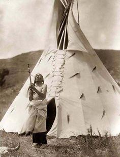 Slow Bull, a Dakota Sioux Medicine Man. It was taken in 1907