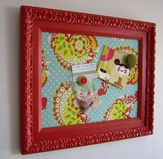 I think you could do this with a cheap cookie sheet, thrift store frame, hot glue, leftover fabric and paint.