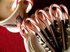 Dip candy canes in chocolate -- perfect for hot cocoa holiday, gift, hot chocolate, chocolate covered, candi cane, chocolate dipped, candy canes, chocolate candies, christma