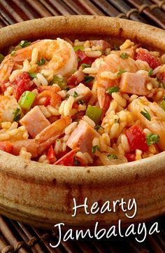 Hearty Jambalaya Recipe - This popular New Orleans dish is loaded with fabulous flavor that everyone will enjoy! Shrimp, ham, onion, celery, rice and Cajun flavor infused broth simmer together to make a delicious jambalaya that's simply irresistible.