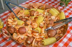 """""""Frogmore Stew"""" or Low Country Boil: 1/4 cup seafood seasoning  5 lb new potatoes 3 lbs cooked kielbasa, 1 inch pieces 8 ears fresh corn 4 lbs fresh shrimp (unpeeled) 1 Beer  Boil a large pot of water beer & Old Bay to taste. Add potatoes & sausage. cook 10 min. Add corn; cook 5 min.  Add shrimp when everything else is almost done. Cook for 3-4 min. Drain off water. Pour contents out onto a picnic table covered with newspaper. Grab a paper plate and a beer and enjoy!"""