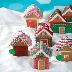 Christmas Village Houses Recipe from Taste of Home -- Find out how to make these cute little houses and more in our Gingerbread House Recipe Collection!