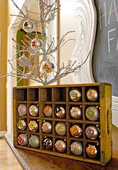 Advent Calendar - use an old Coke tray with dividers, and put ornaments or other pieces in each section.  Merry Christmas!